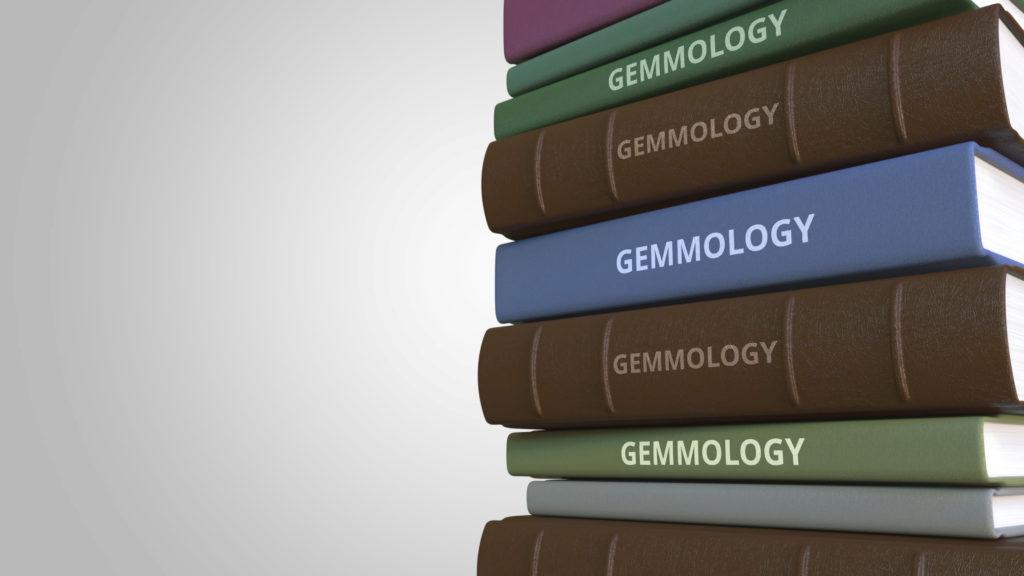 une pile de livres de gemmologie